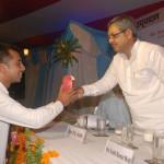 Hon. Education Minister Mr.P.K.Shahi awarding CIMAGE student